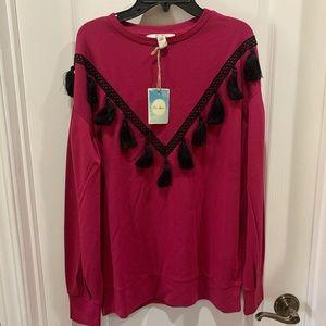 Women's long sleeve redHobo top, with black tassel